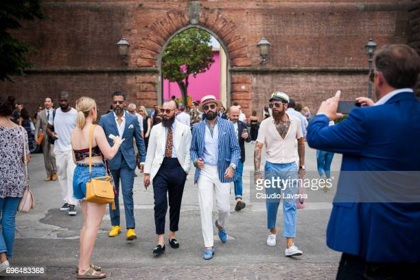 Group of guests wearing light blue Gentlemen outfit are seen during Pitti Immagine Uomo 92 at Fortezza Da Basso on June 15 2017 in Florence Italy