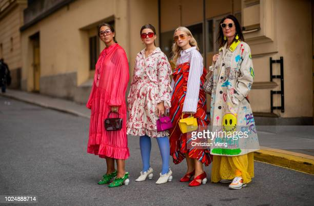 Group of guests wearing mulit color dresses seen during Stockholm Runway SS19 on August 28 2018 in Stockholm Sweden