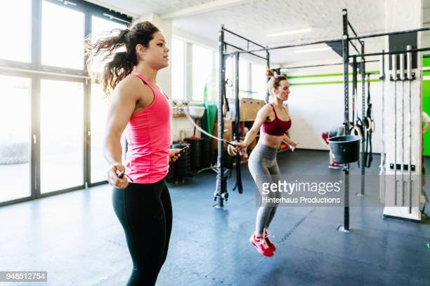 group of gym goers using skipping ropes - skipping rope stock pictures, royalty-free photos & images