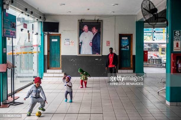 A group of Haitian kids play at a bus station hall in Lima on July 10 2020 On March 16 2020 the order of compulsory national confinement due to the...