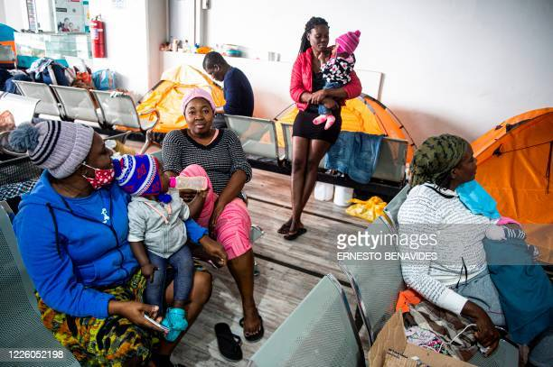 A group of Haitians women are seen at a bus station in Lima on July 10 2020 On March 16 2020 the order of compulsory national confinement due to the...