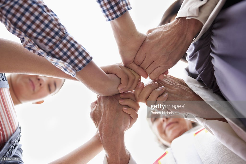 Group of hands clasped in prayer : Stock Photo