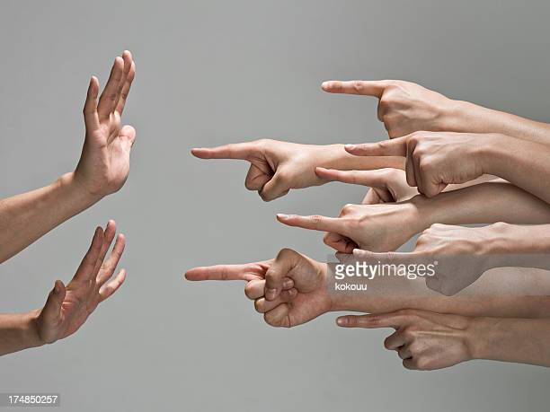 group of hands with pointing finger - dismissal stock photos and pictures