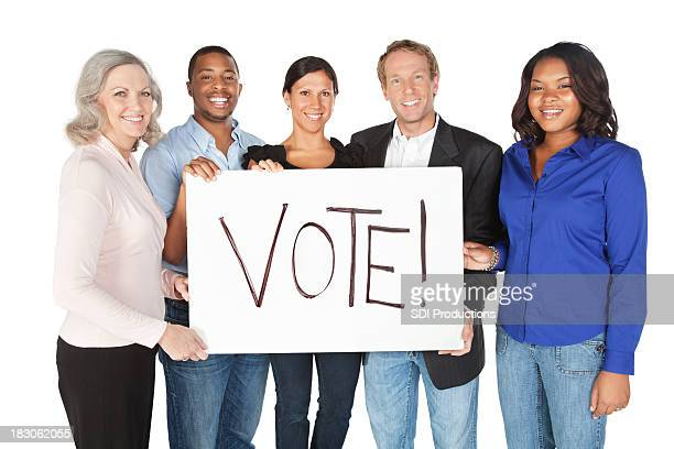 Group of Happy Adults Holding a Vote Sign