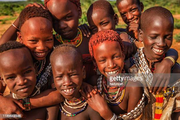 group of happy african children, east africa - hamer tribe stock pictures, royalty-free photos & images