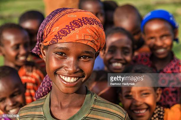 group of happy african children, east africa - human arm stockfoto's en -beelden