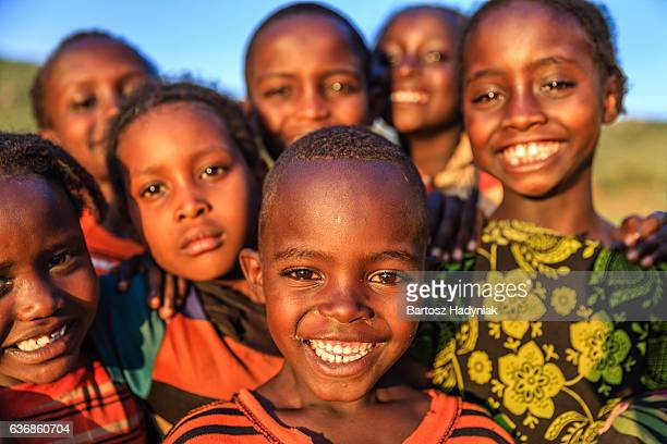 group of happy african children, east africa - afrika stockfoto's en -beelden