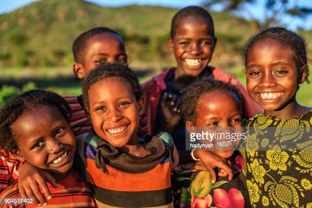 group of happy african children, east africa - offspring stock pictures, royalty-free photos & images