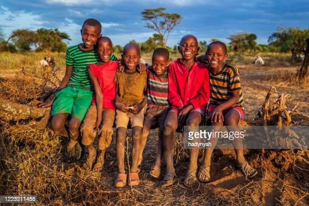 group of happy african children from masai tribe, kenya, africa - east african tribe stock pictures, royalty-free photos & images