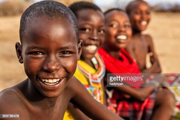 group of happy african children from samburu tribe, kenya, africa - popolo di discendenza africana foto e immagini stock