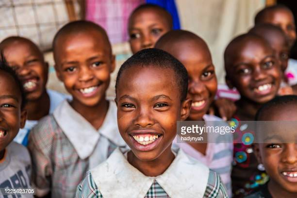 group of  happy african children, orphanage in nairobi, kenya, east africa - orphan stock pictures, royalty-free photos & images