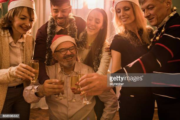 Group of happy business people toasting with champagne on a Christmas party.