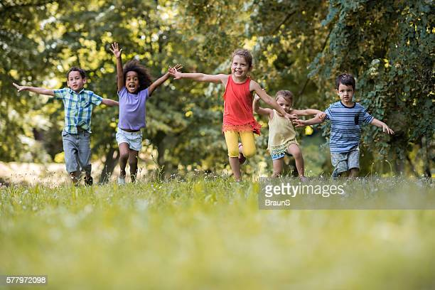 group of happy children having fun while running in nature. - dia - fotografias e filmes do acervo