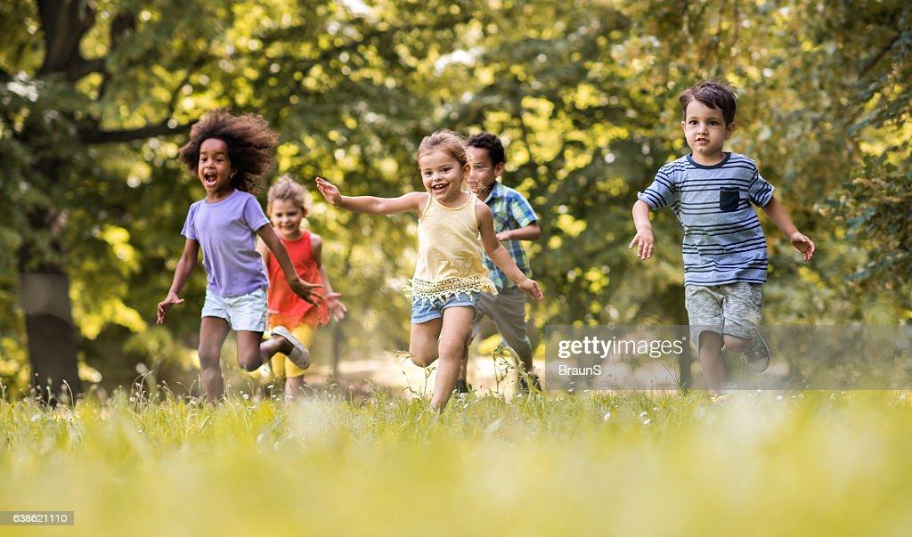 Group of happy children having fun while running in nature. : Stock Photo