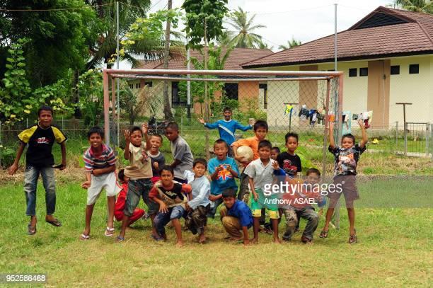 group of happy children jumping Banda Aceh Sumatra Indonesia