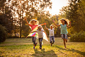 Group of happy children running in public park