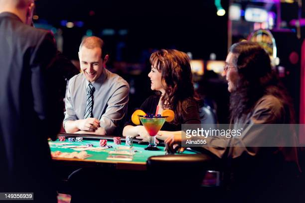 Group of happy diverse people at the blackjack table