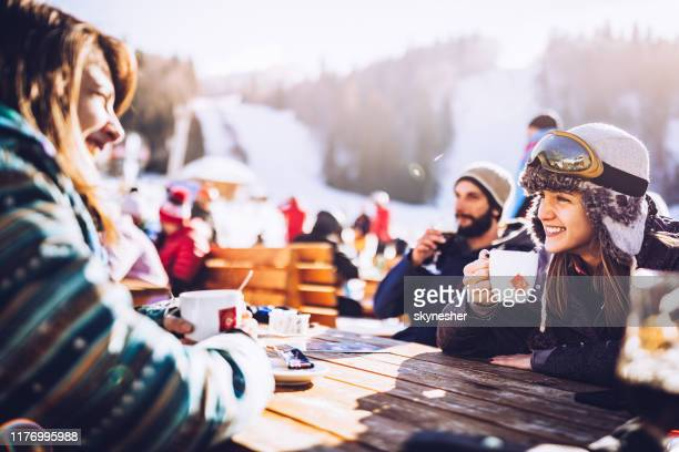 group of happy friends communicating on a break from skiing in a cafe. - skiing stock pictures, royalty-free photos & images