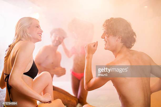 Group of happy friends dancing in a hot tub.
