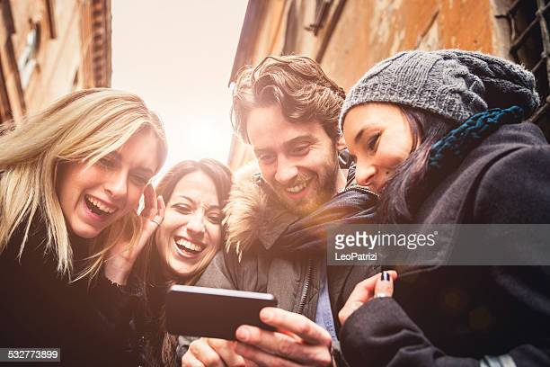 group of happy friends doing conference call - mid section stock photos and pictures