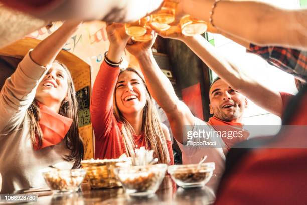 group of happy friends drinking beer at the brewery - ale stock pictures, royalty-free photos & images