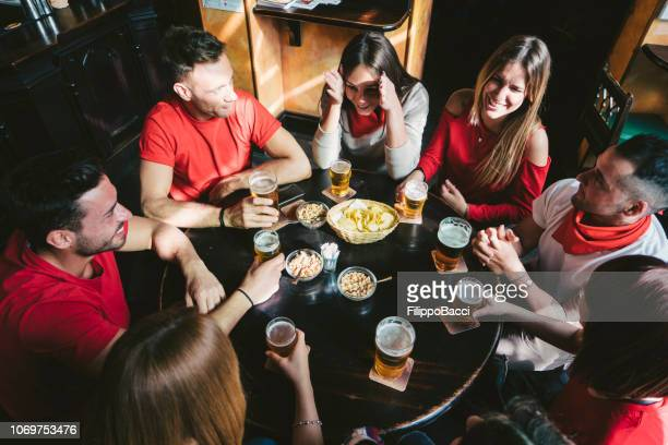 group of happy friends drinking beer at the brewery - the brewery london stock photos and pictures