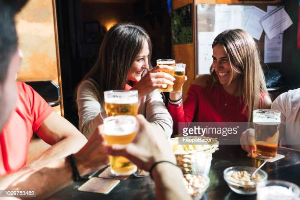 group of happy friends drinking beer at the brewery - south east england stock pictures, royalty-free photos & images