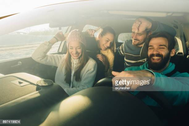 group of happy friends having fun while dancing during a road trip in the car. - passenger stock pictures, royalty-free photos & images