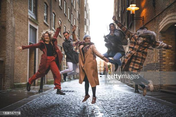 group of happy friends meets - tourist stock pictures, royalty-free photos & images