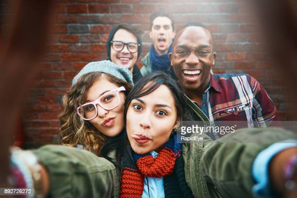 group of happy friends take selfie outdoors - adolescente imagens e fotografias de stock