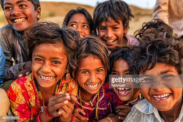 group of happy gypsy indian children, desert village, india - armoede stockfoto's en -beelden