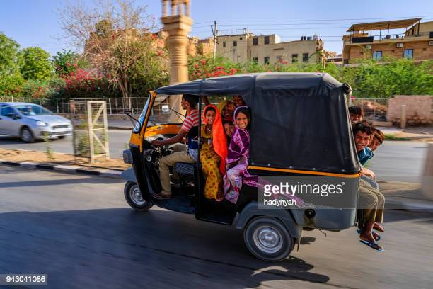 group of happy gypsy indian children riding tuk-tuk, india - auto rickshaw stock pictures, royalty-free photos & images