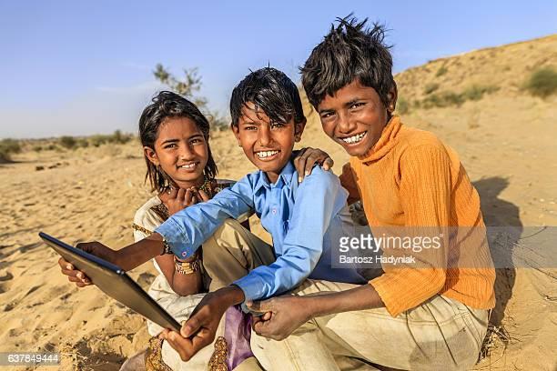 group of happy gypsy indian children using digital tablet, india - utvecklingsland bildbanksfoton och bilder