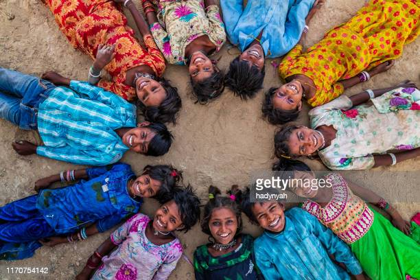 group of happy indian children, desert village, india - minority groups stock pictures, royalty-free photos & images