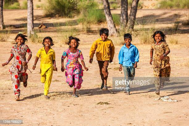 group of happy indian children, desert village, india - nomadic people stock pictures, royalty-free photos & images