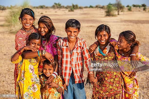 Group of happy Indian children, desert village, India