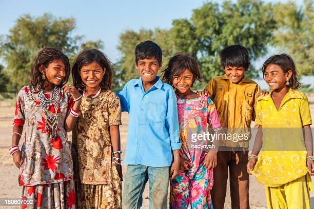 Group of happy Indian children, desert village, India