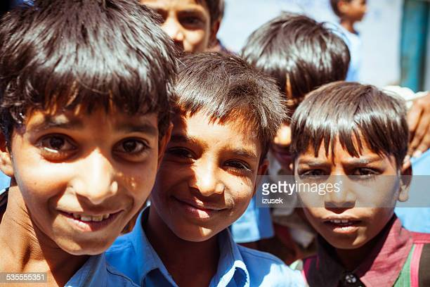 group of happy indian children - izusek stock photos and pictures