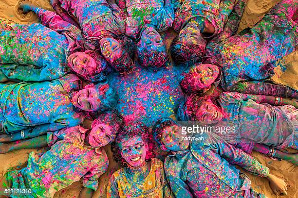 group of happy indian children playing holi, desert village, india - religion stock pictures, royalty-free photos & images