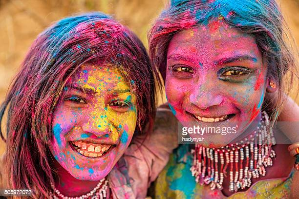 Group of happy Indian girls playing holi, desert village, India