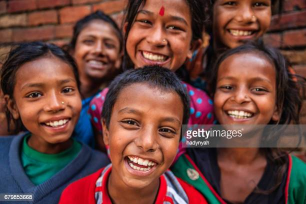 group of happy nepalese children in bhaktapur, kathmandu valley - nepal stock pictures, royalty-free photos & images