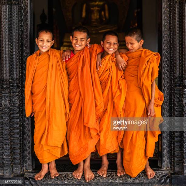 group of happy novice buddhist monks, bhaktapur - ceremonial robe stock pictures, royalty-free photos & images