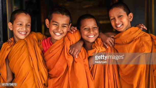group of happy novice buddhist monks, bhaktapur - stupa stock pictures, royalty-free photos & images