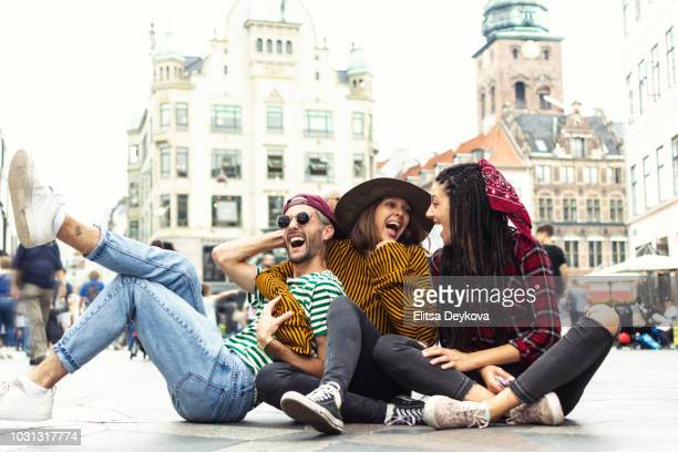 group of happy people enjoying copenhagen denmark - copenhagen stock pictures, royalty-free photos & images