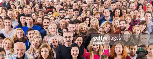 group of happy people looking at camera. - crowd stock pictures, royalty-free photos & images