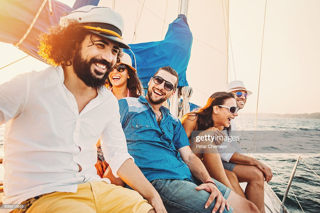 Group of happy people sailing in the summer : Stock Photo