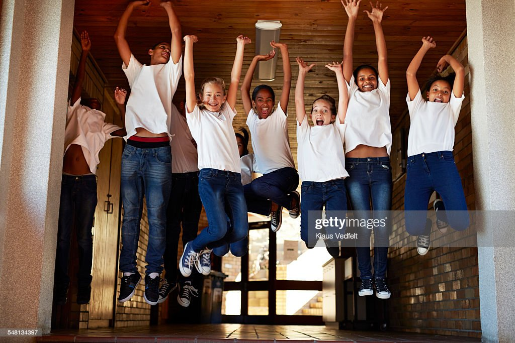 Group of happy students jumping up in the air : Stock Photo