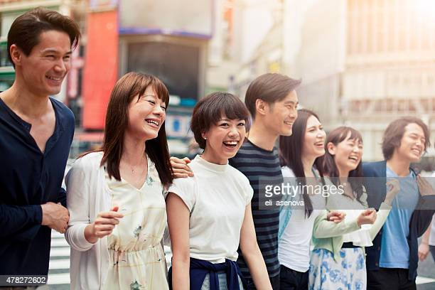 Group of happy young japanese people fun outdoors, Tokyo.