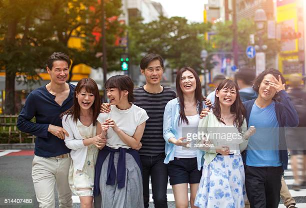 group of happy young japanese people fun outdoors, tokyo. - global fashion collective stock pictures, royalty-free photos & images