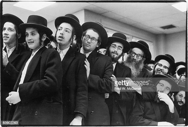 A group of Hasidic men crowd together at a unidentified gathering in the Crown Heights neighborhood of New York New York 1960s